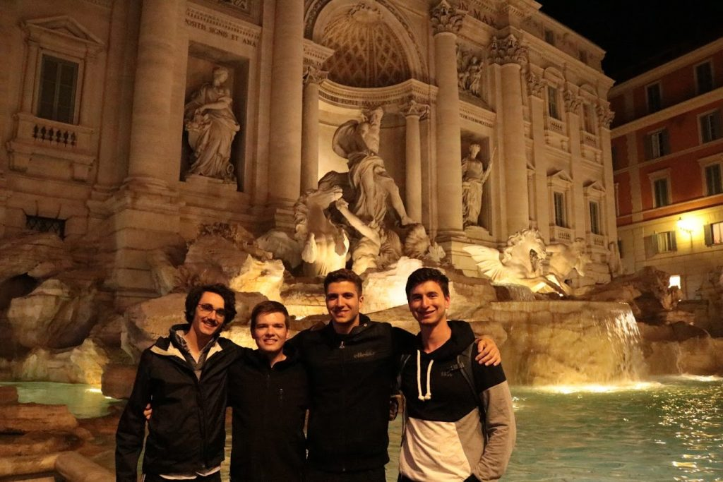 Joshua Turner and 3 other students at the Trevi Fountain in Rome, Italy