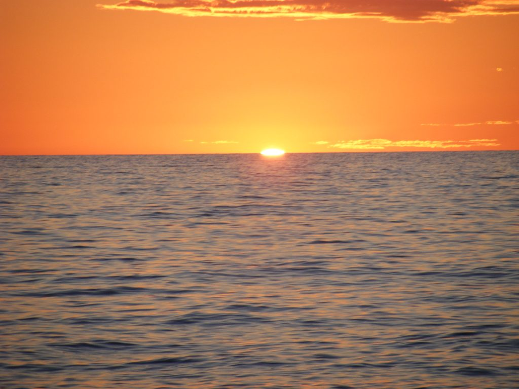 Orange sunset over Lake Superior on Agawa Bay, Ontario. Photo credit: Helena Jacoba