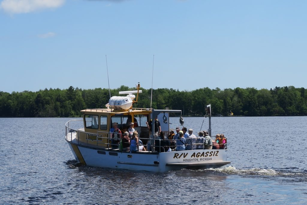 Michigan Tech Research Vessel Agassiz on Portage Canal in Houghton MI with children and adults aboard.