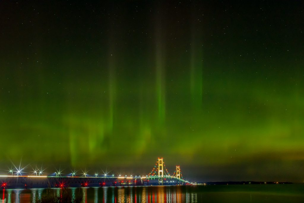 Lit up at night is the Mackinac Bridge in the Northern Lights. Photo credit: Jason Gillman