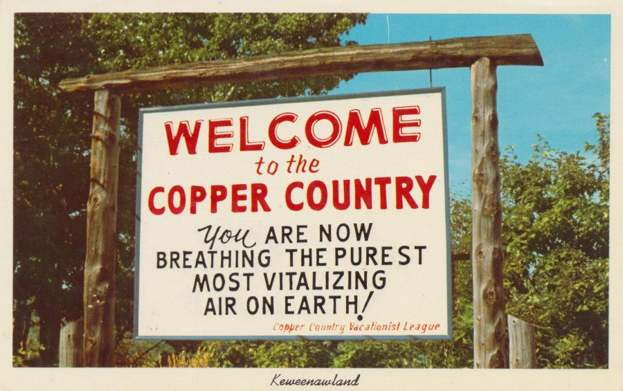 Historical sign once hung on posts at the entrance to the city of Houghton, Michigan that says, Welcoome to the Copper country. You are now breathing the purest most vitalizing air on earth!