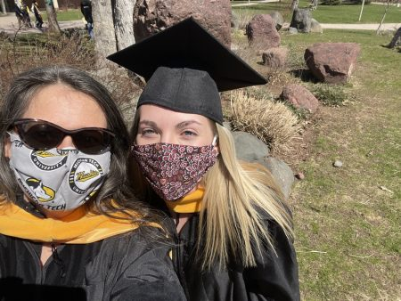 Dr. Jarvie-Eggarts and Amanda Singer in cap and gown