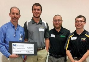 Tech students Eric Bauer (left), Eric Hupf (middle), and Jake Rosio (right) take first place at Student Night