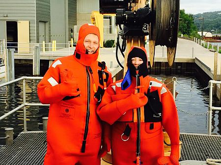 Brice Grunert  and Colleen B. Mouw  practicing the use of their survival suits for use at sea in case of emergency.