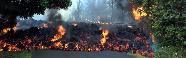 Effusive Volcanic Flow showing lava traveling down a road.