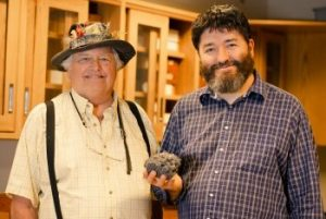 "William ""Bill"" Rose and Rüdiger Escobar-Wolf with a sample of volcanic rock."