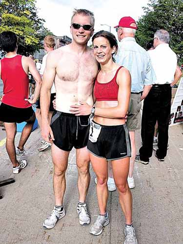 Karl Walczak and Margot Hutchins after completing the Canal Run.  Photo courtesy of the Daily Mining Gazette.