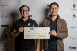Kyle Ludwig and Adam Weber accepting their check for Best Technology at the Bob Mark Elevator Pitch Competition.