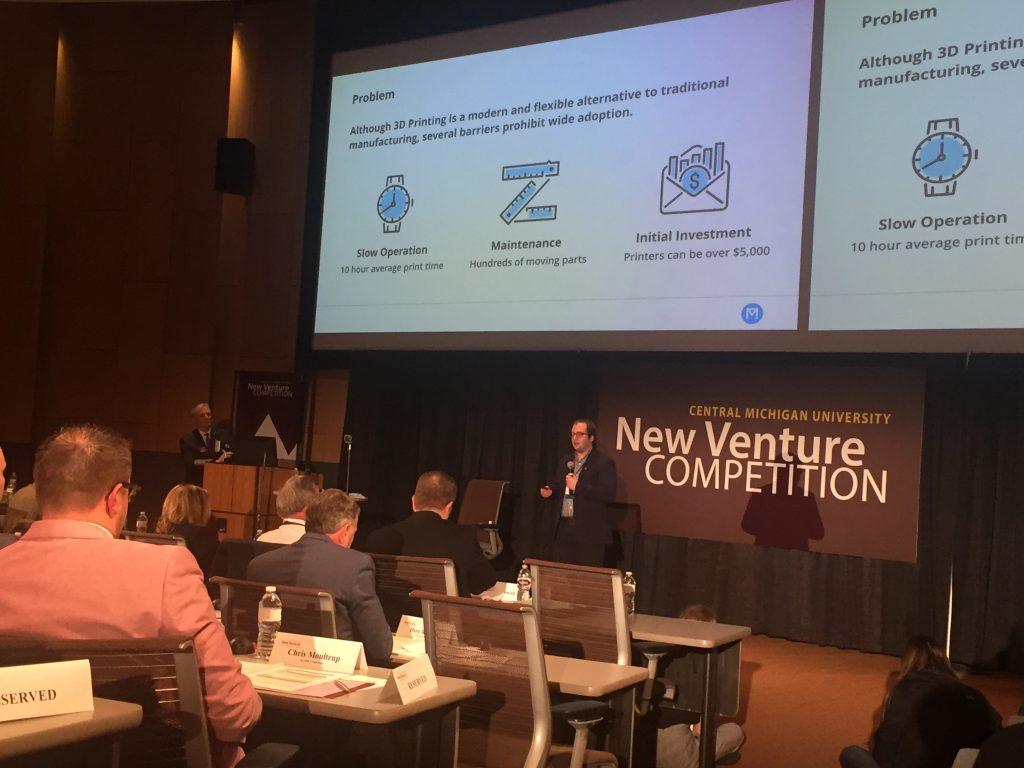 Weber presenting for Makerhub to a panel of entrepreneurs