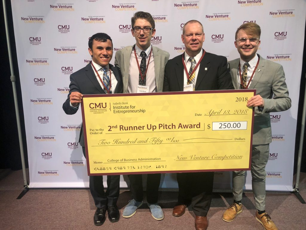From left to right, Sheahan, Pfund, Baker (mentor), and Horrigan accept award check