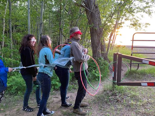 A group completes an obstacle course