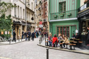 Paris, France - May 25, 2014: A group of young women enjoy afternoon beverages al fresco at a cafe on Rue Galande in the Latin Quarter of Paris. .