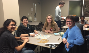 students sitting at a table playing Spanish Scrabble