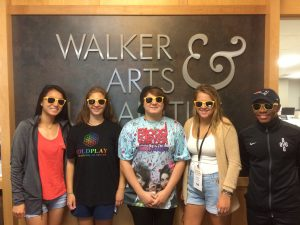 New humanities students standing in front of the Walker Arts and Humanities sign