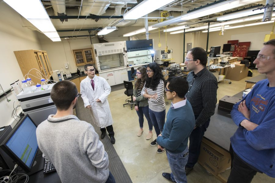 A professor in a Michigan Tech lab with seven undergraduate students