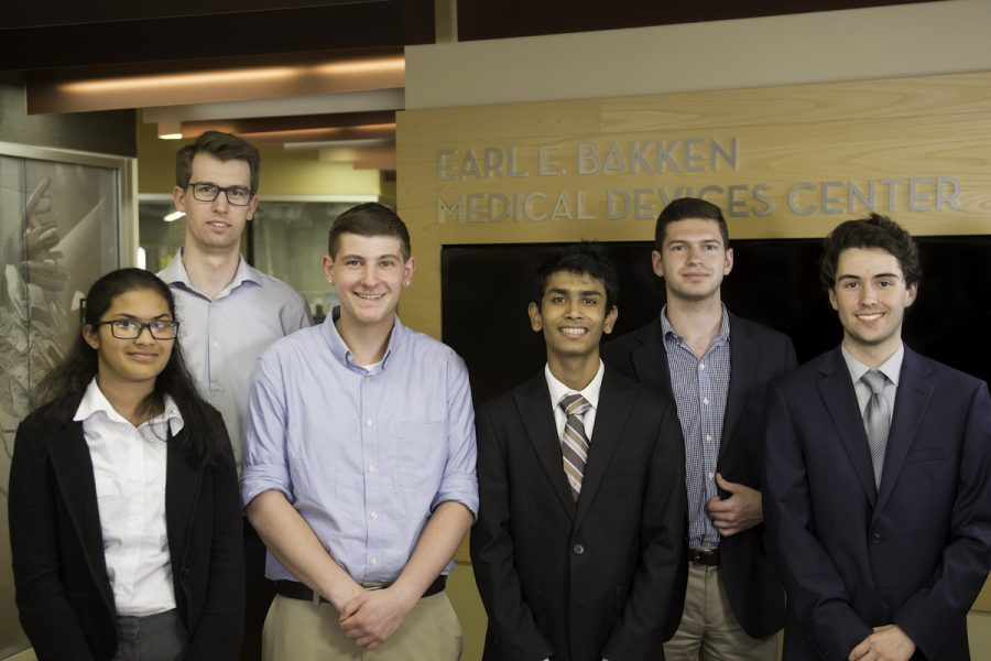 Six young people stand in front of a wall that says Earl E. Bakken Medical Devices Center