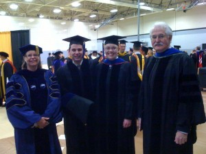 Left to right, Dr. Jackie Huntoon, dean of the graduate school, Cameron Hartnell, his fiancé Dr. Elizabeth Norris, and Dr. Patrick Martin, Cameron's doctoral advisor and chair of the Social Sciences department.