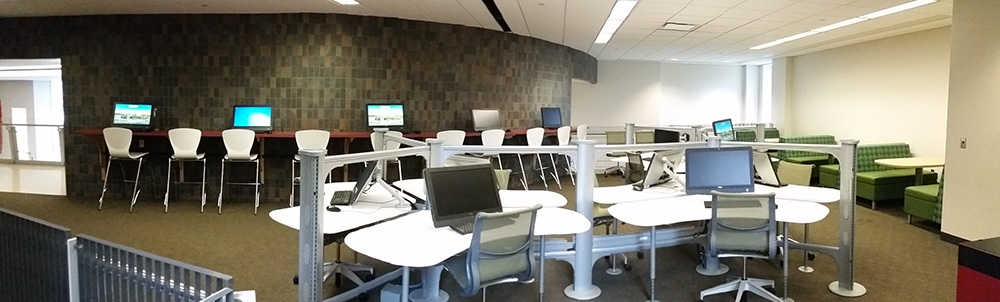 The old loft area, but with newly revealed functionalities: This redesigned space has four different styles of work space. Collaborative desktop computers that can seat up to three people per desk (seen in the foreground), a multi-user computer bar (back left) and booth style seating (back right). All 14 of the computers in the loft are accessible 24 hours per day, with an active HuskyCard.