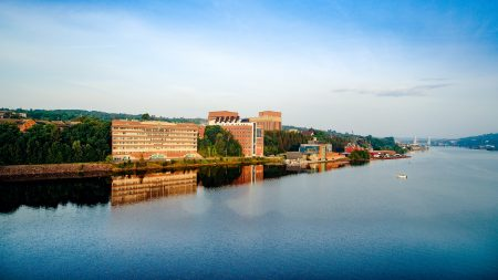 A view of the Michigan Tech campus skyline, taken by a drone flying over Portage Canal. Part of campus is situated on the water, at the shore of Portage Canal.