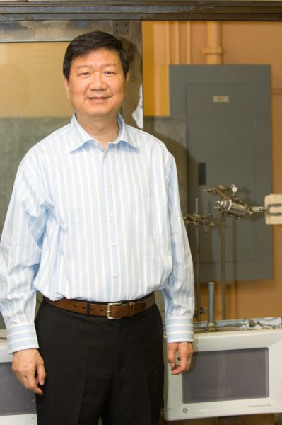 Jim Hwang stands in his lab.
