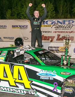 Justin Mondeik celebrates near his race car