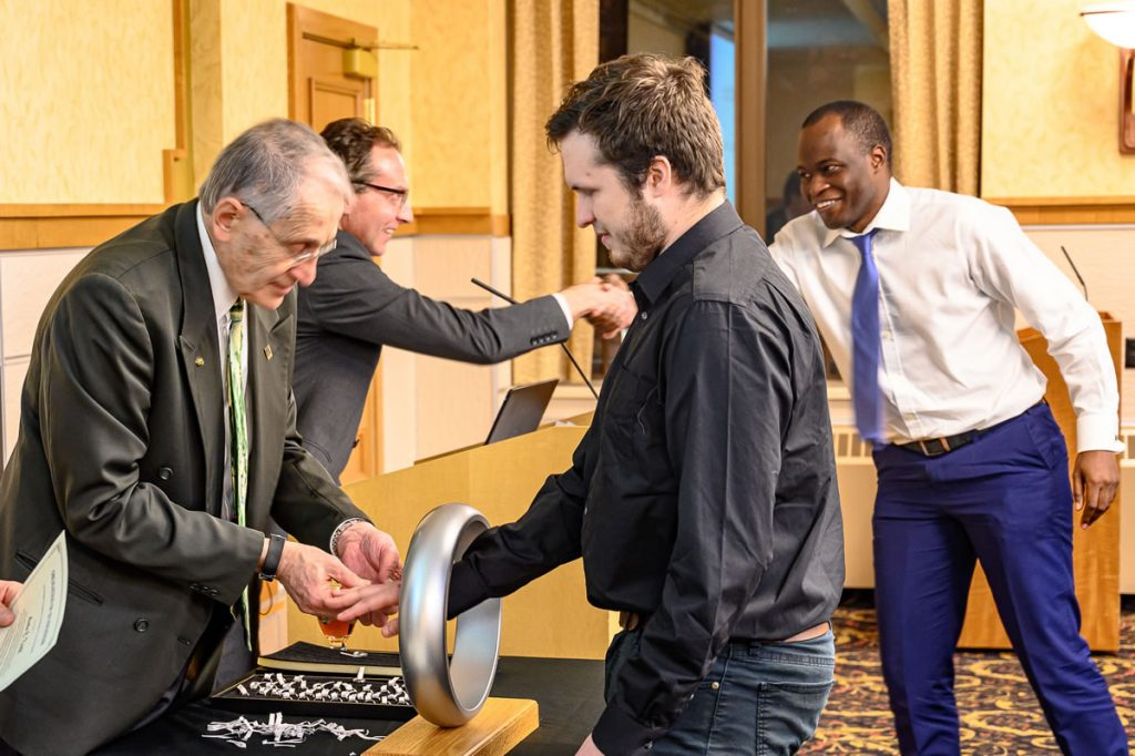 MEEM Banquet 2019 showing attendees shaking hands.