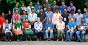 Lynn and Claudio Mazzoleni posing with a large group of researchers in India