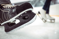 man-x-s-hockey-women-x-figure-skates-ice-background-closeup-blades-77630422