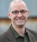 Dr. Tim Scarlett