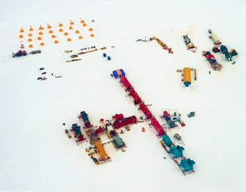 Drone view of camp setup on ice.