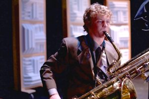 Student playing a sax