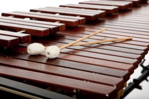 A background of marimba and mallets