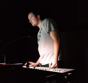 Henry Sendek at sound board during a performance