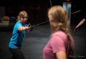 2 females sword fighting