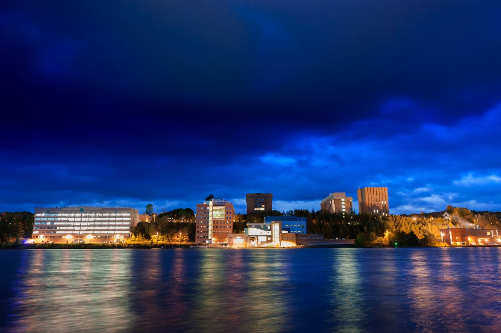 A view of campus at night from across the Keweenaw Waterway.